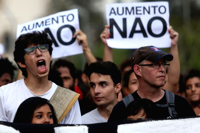 Brazilians take part in a protest against the rising fares of public transportation, in Sao Paulo, Brazil, on Jan. 27, 2015.