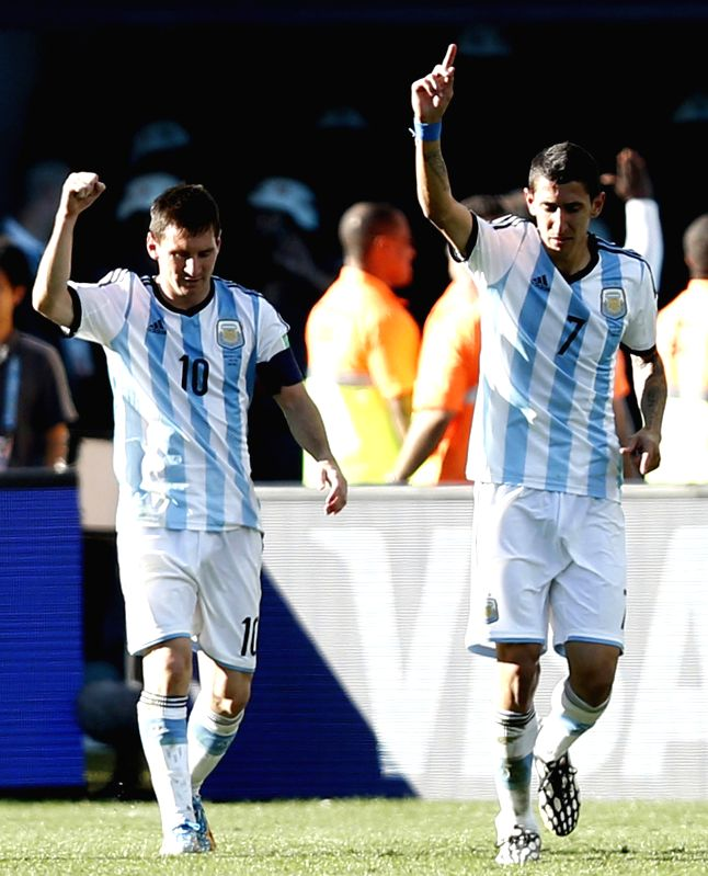 Argentina's Angel Di Maria (R) celebrates a goal with Lionel Messi during the extra time of a Round of 16 match between Argentina and Switzerland of 2014 FIFA ...