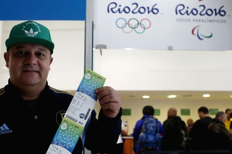SAO PAULO, July 22, 2016 - A man displays his tickets for the Rio 2016 Olympic Games at an official ticket office in Sao Paulo, Brazil, on July 21, 2016.