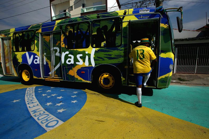 "The driver Edilson, known as ""Fumassa"", gets in the ""Copa Bus"" in Santo Andre, Sao Paulo state, Brazil, on July 2, 2014. The ""Copa ..."