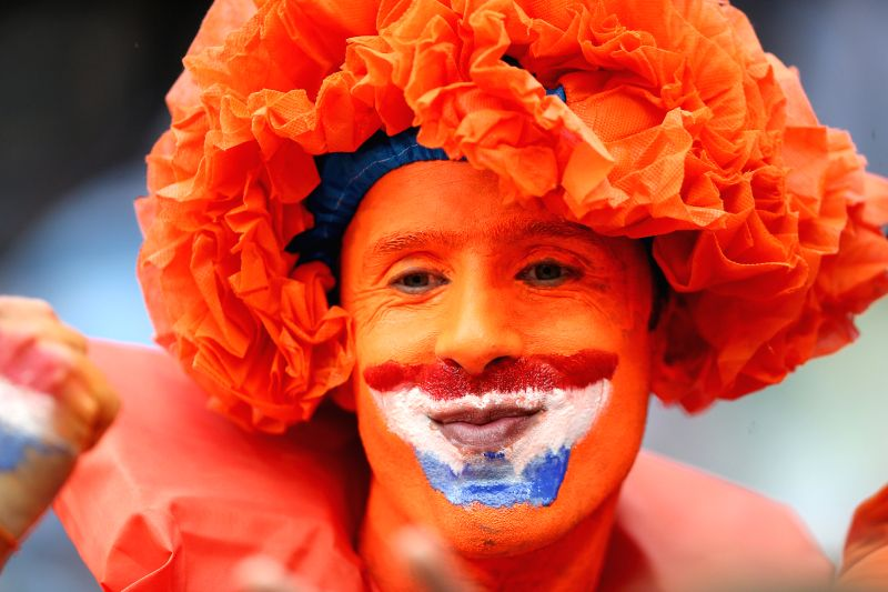 A Netherlands' fan poses before a semifinal match between Netherlands and Argentina of 2014 FIFA World Cup at the Arena de Sao Paulo Stadium in Sao Paulo, Brazil, .