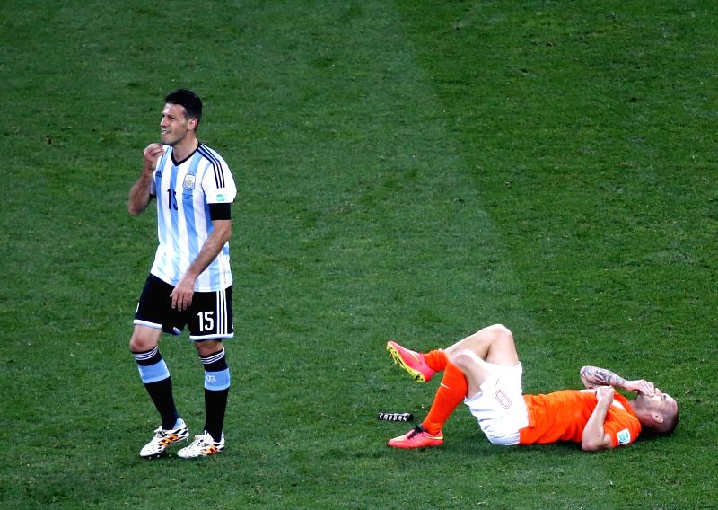 Netherlands' Wesley Sneijder falls down during a semifinal match between Netherlands and Argentina of 2014 FIFA World Cup at the Arena de Sao Paulo Stadium in Sao .