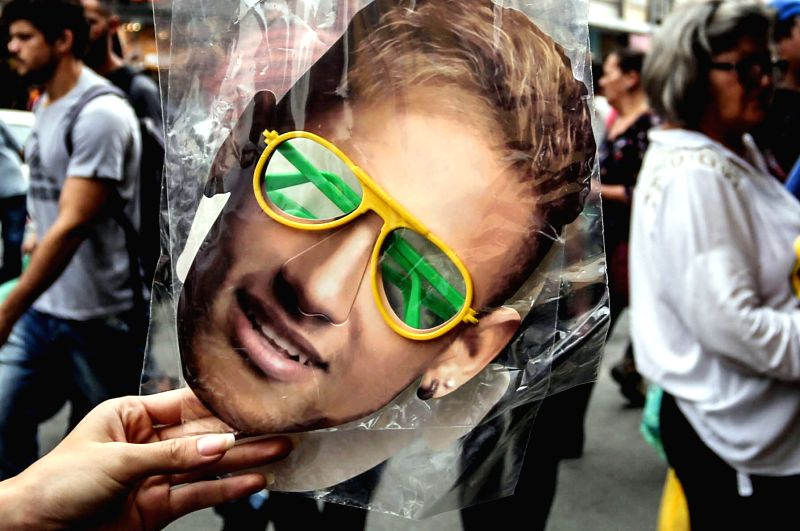 SAO PAULO, June 14, 2018 - A mask of Brazilian national soccer team's player Neymar is displayed for sale in Sao Paulo, Brazil, on June 13, 2018. The Russia 2018 FIFA World Cup will be held from June ...