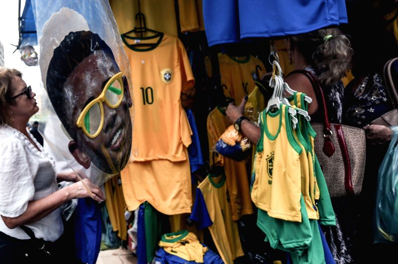 SAO PAULO, June 14, 2018 - A mask of Brazilian national soccer team's player Gabriel Jesus is displayed for sale in Sao Paulo, Brazil, on June 13, 2018. The Russia 2018 FIFA World Cup will be held ...
