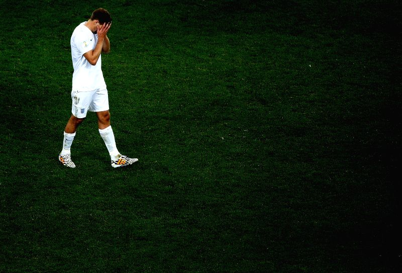 England's Steven Gerrard reacts after a Group D match between Uruguay and England of 2014 FIFA World Cup at the Arena de Sao Paulo Stadium in Sao Paulo, Brazil, ..