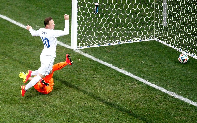 England's Wayne Rooney shoots a goal during a Group D match between Uruguay and England of 2014 FIFA World Cup at the Arena de Sao Paulo Stadium in Sao Paulo, ...