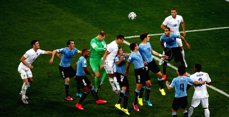 Players jump for the ball during a Group D match between Uruguay and England of 2014 FIFA World Cup at the Arena de Sao Paulo Stadium in Sao Paulo, Brazil, June ..