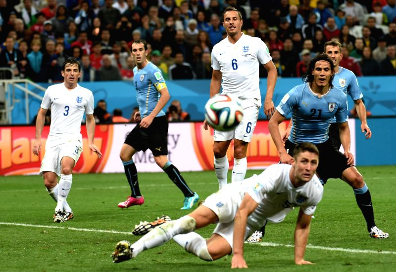 Players react during a Group D match between Uruguay and England of 2014 FIFA World Cup at the Arena de Sao Paulo Stadium in Sao Paulo, Brazil, June 19, ...