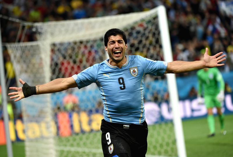 Uruguay's Luis Suarez celebrates for his second goal during a Group D match between Uruguay and England of 2014 FIFA World Cup at the Arena de Sao Paulo Stadium ..