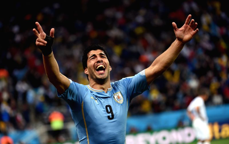 Uruguay's Luis Suarez celebrates for his goal during a Group D match between Uruguay and England of 2014 FIFA World Cup at the Arena de Sao Paulo Stadium in Sao ..