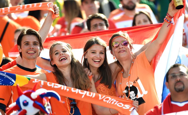 Supporters of Netherlands pose before a Group B match between Netherlands and Chile of 2014 FIFA World Cup at the Arena de Sao Paulo Stadium in Sao Paulo, Brazil, on