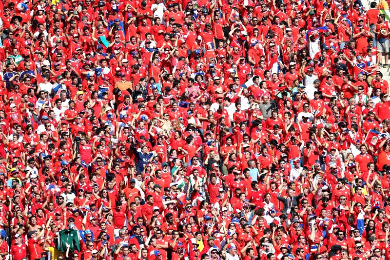 Supporters of Chile cheer before a Group B match between Netherlands and Chile of 2014 FIFA World Cup at the Arena de Sao Paulo Stadium in Sao Paulo, Brazil, on June