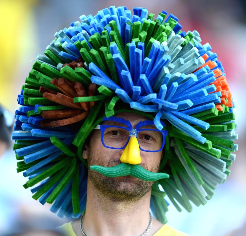 A football fan waits for a Group H match between South Korea and Belgium of 2014 FIFA World Cup at the Arena de Sao Paulo Stadium in Sao Paulo, Brazil, on June ...