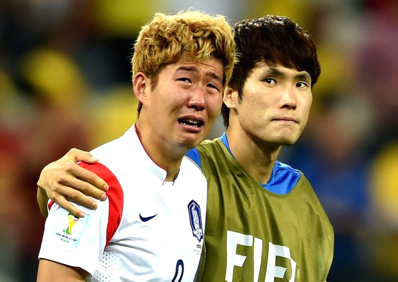 Korea Republic's Son Heung Min (L) reacts after a Group H match between Korea Republic and Belgium of 2014 FIFA World Cup at the Arena de Sao Paulo Stadium in Sao
