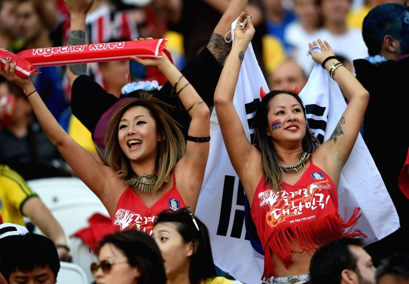 South Korea's fans cheer prior to a Group H match between South Korea and Belgium of 2014 FIFA World Cup at the Arena de Sao Paulo Stadium in Sao Paulo, Brazil, ..