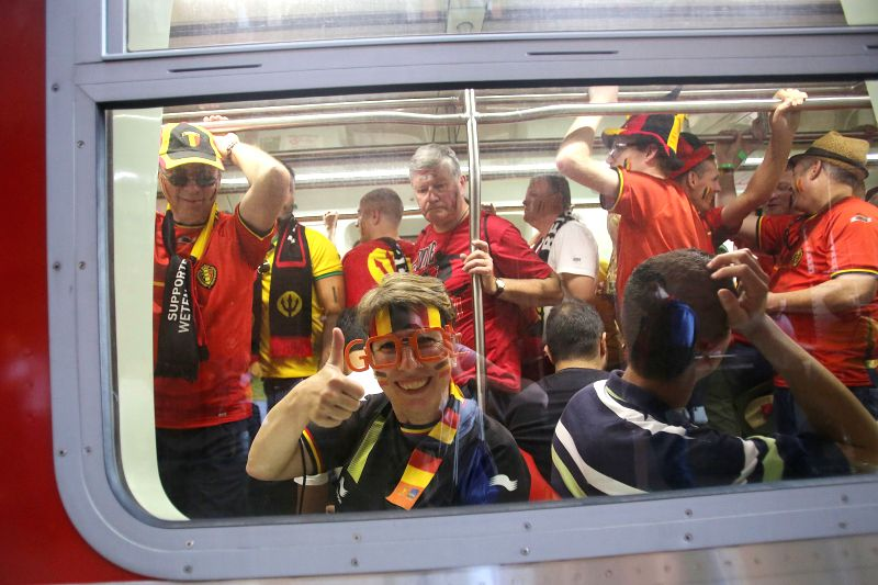 Supporters of Belgium are seen on a train to the Arena Sao Paulo Stadium where a Group H match between Belgium and Korea Republic of 2014 FIFA World Cup is held, .