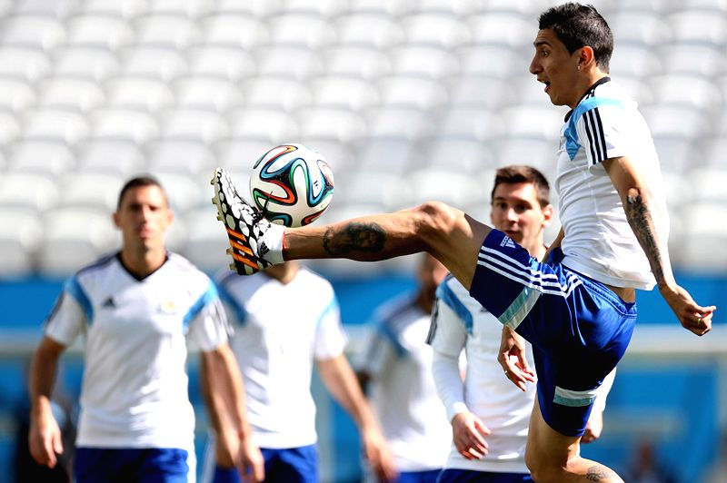 Argentina's Angel Di Maria (front) controls the ball during a training session in Sao Paulo, Brazil, on June 30, 2014, ahead of a Round of 16 match between ...