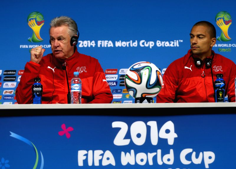 Switzerland's Ottmar Hitzfeld (L) attends a press conference in Sao Paulo, Brazil, on June 30, 2014. Switzerland will face Argentina here in a Round of 16 match ..