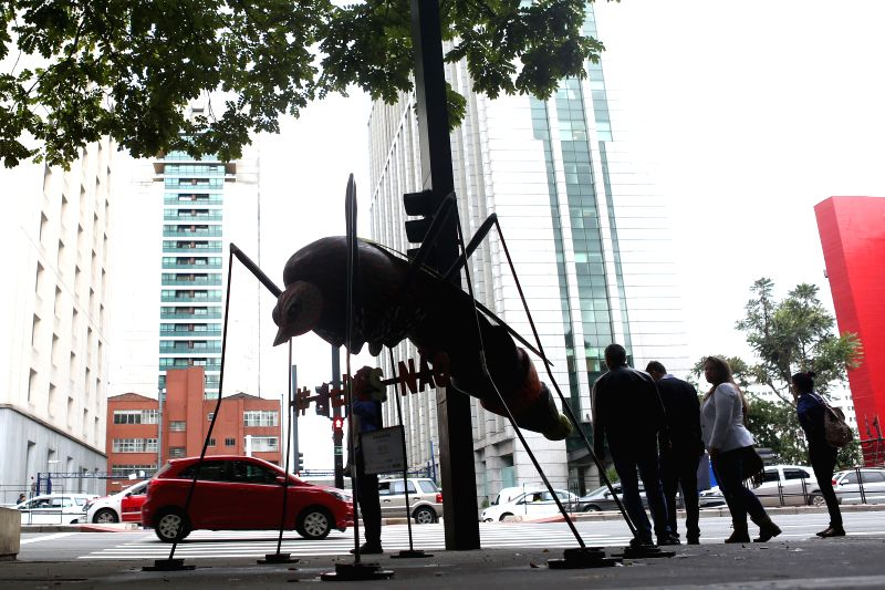 SAO PAULO, June 4, 2016 - People stand near a sculpture of an Aedes Aegypti mosquito, created by artist Andre Farkas, in Sao Paulo, Brazil, on June 3, 2016. Brazilian Health Minister Ricardo Barros ... - Andre Farkas