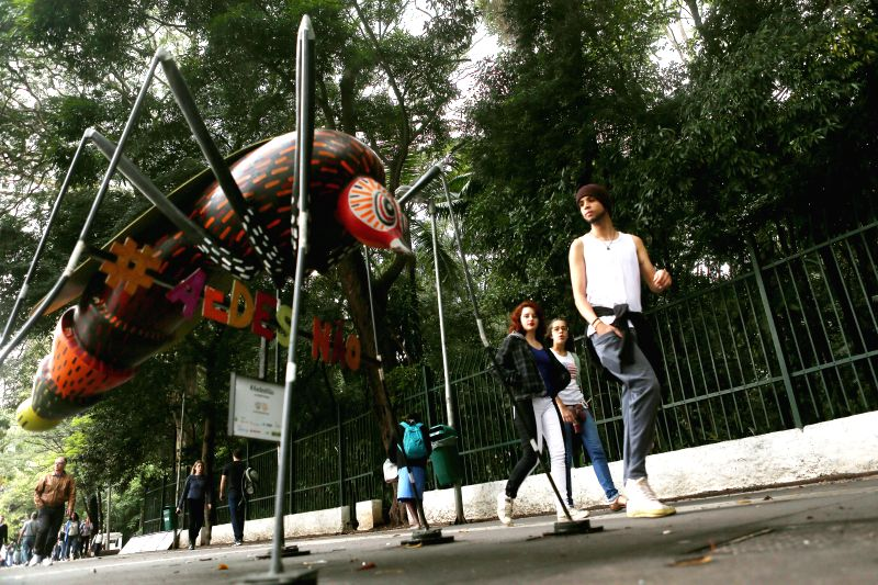 SAO PAULO, June 4, 2016 - People walk past a sculpture of an Aedes Aegypti mosquito, created by artist Andre Farkas, in Sao Paulo, Brazil, on June 3, 2016. Brazilian Health Minister Ricardo Barros on ... - Andre Farkas