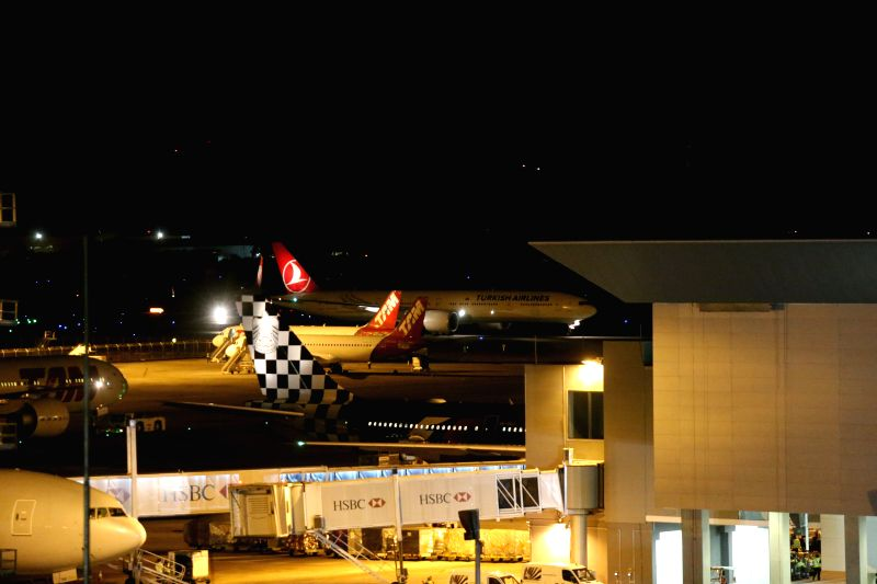 A plane of the Turkish Airlines (back) is seen in the landing strip of the International Airport of Sao Paulo, Brazil, on March 30, 2015. According to local ...