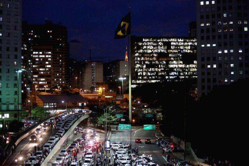 SAO PAULO, May 11, 2016 - Taxi drivers block an avenue in a protest against the operation of services of private transport through smartphone applications like Uber, in Sao Paulo, Brazil, on May 10, ...