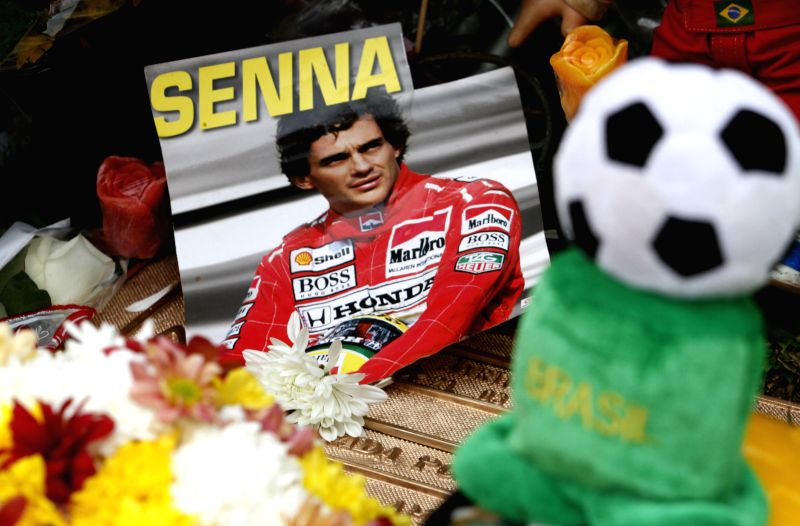 An image of Brazilian driver Ayrton Senna da Silva is placed in his tomb during the 20th anniversary of his death, in Sao Paulo, Brazil, on May 1, 2014. The ...