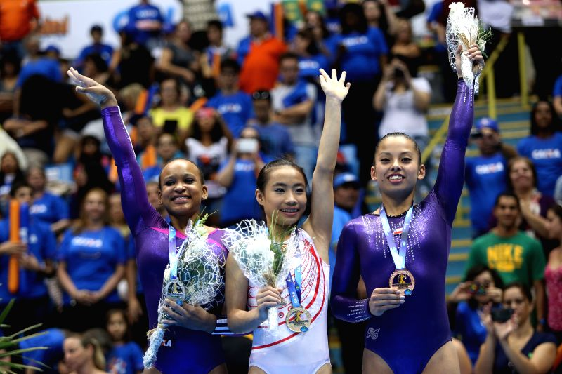 Gold medalist Deng Yalan (C) of China, silver medalist Rebeca Andrade (L) of Brazil and bronce medalist Franchesca Santi of Chile pose during the awarding ceremony ...