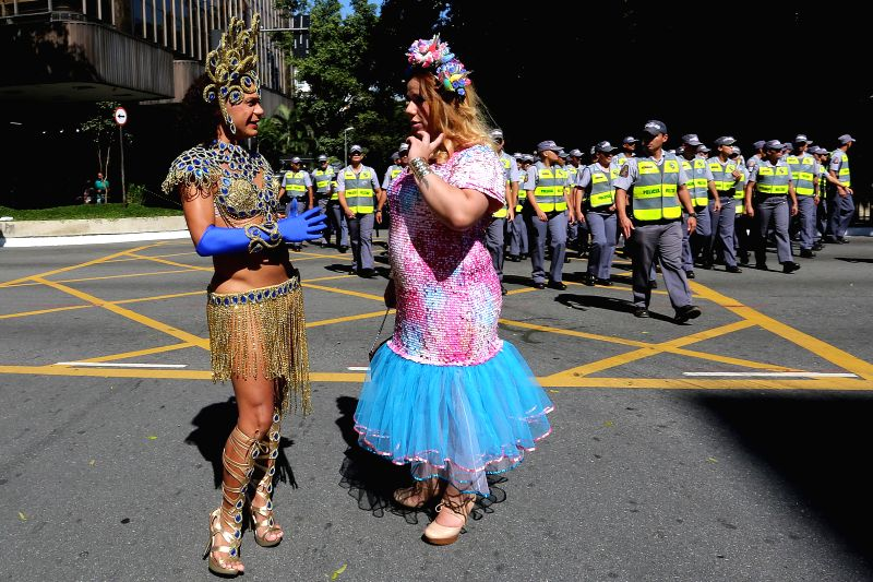 Two people take part during the Gay Pride Parade, in Sao Paulo, Brazil, on May 4, 2014.