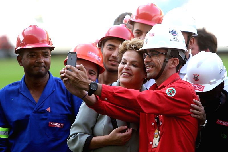 Brazil's President Dilma Rousseff (C, Front) poses with workers during her visit to the Sao Paulo Arena in Sao Paulo, Brazil, on May 8, 2014. Sao Paulo will host ...