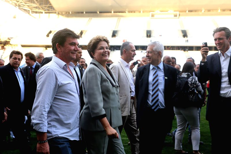 Brazil's President Dilma Rousseff (C) visits the Sao Paulo Arena in Sao Paulo, Brazil, on May 8, 2014. Sao Paulo will host the opening match of the FIFA World Cup ..