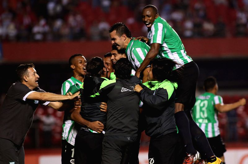 Sao Paulo: Players of Atletico Nacional celebrate the victory after the semifinal match of the South American Cup against Sao Paulo in the Morumbi Stadium, in the city of Sao Paulo, Brazil, on Nov. ..