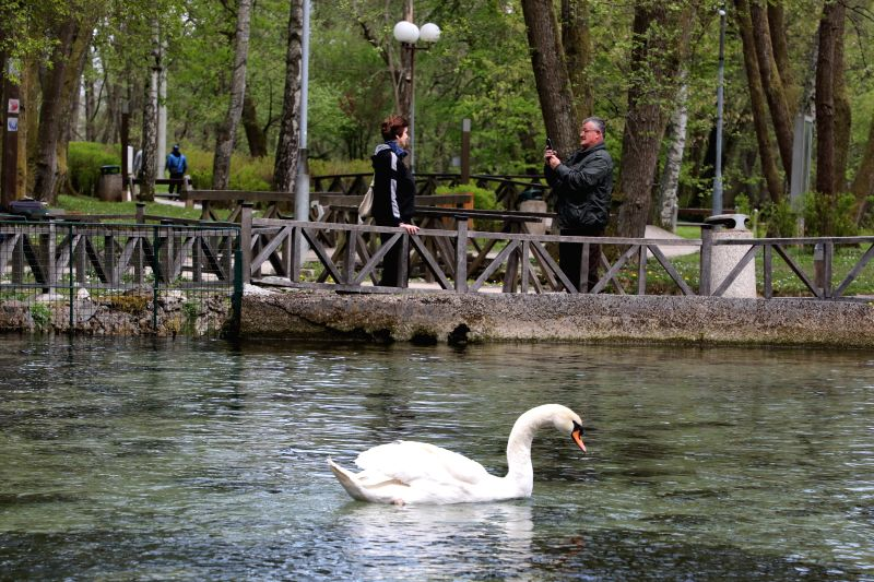 SARAJEVO, April 25, 2017 - A man takes photos of his wife at Vrelo Bosne public park on the outskirts of Sarajevo, Bosnia and Herzegovina, on April 25, 2017. Vrelo Bosne, also called Spring of the ...