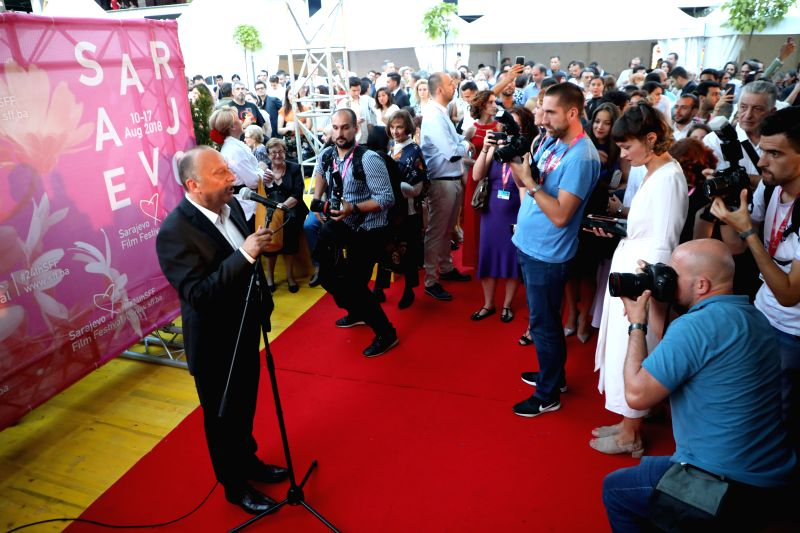 SARAJEVO, Aug. 10, 2018 - Sarajevo Film Festival Director Mirsad Purivatra (L, Front) welcomes guests in Sarajevo, Bosnia and Herzegovina, on Aug. 10, 2018. The 24th Sarajevo Film Festival kicked off ...