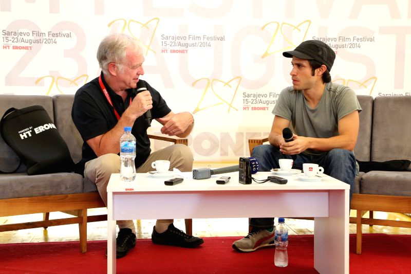 Mexican actor and director Gael Garcia Bernal (R) speaks to media at the 20th Sarajevo Film Festival at the Festival Square, in Sarajevo, Bosnia-Herzegovina, on ...