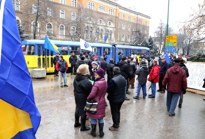 People gather in front of the Presidency of Bosnia and Herzegovina (BiH) in Sarajevo on Feb. 7, 2015. Some 100 people held protest on Saturday here to mark the ...