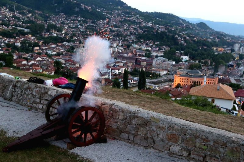 A canon fires to signal the Iftar time of the day in the old city of Sarajevo, Bosnia-Herzegovina, on July 4, 2014. Ramadan is the holy month for Muslim people. ...
