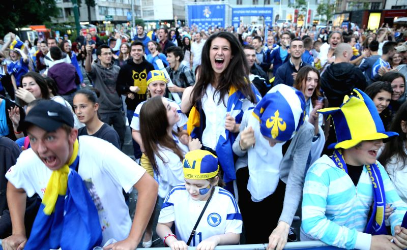 Fans cheer for the team as they watch the televised 2014 FIFA World Cup Group F match between Bosnia and Herzegovina and Iran, in front of the BBI Center at ...