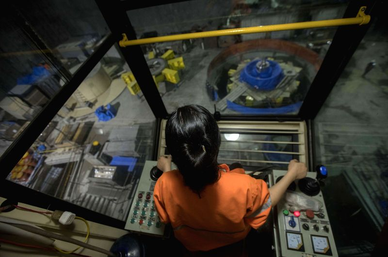 SARAYUNGA, April 18, 2017 - A Chinese employee works in a lifter inside the engine room of the Minas-San Francisco hydroelectric project in Sarayunga, in the province of Azuay, Ecuador, on April 13, ...