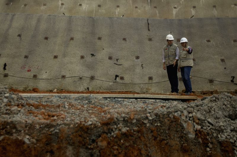 SARAYUNGA, April 18, 2017 - A Chinese engineer and an Ecuadorian engineer supervise work at the site of the Minas-San Francisco hydroelectric project in Sarayunga, in the province of Azuay, Ecuador, ...