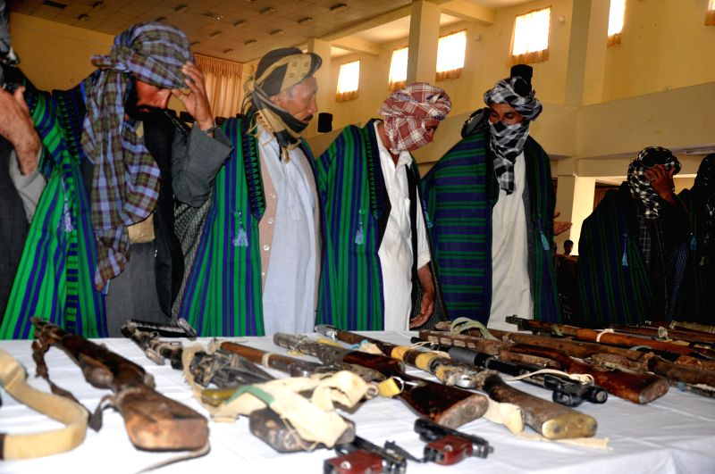 Taliban militants attend a surrender ceremony in Saripul province, Afghanistan, Aug. 12, 2014. A total of 45 Taliban militants Tuesday surrendered to the government