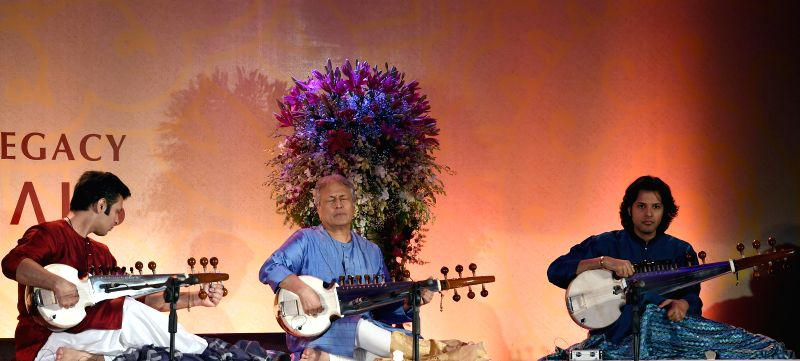 Sarod maestro Ustad Amjad Ali Khan and his sons Amaan Ali Khan and Ayaan Ali Khan perform during a private concert in Bangalore on Aug 23, 2014. - Amaan Ali Khan and Ayaan Ali Khan