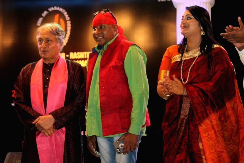 Sarod maestro Ustad Amjad Ali Khan, Percussionist Sivamani and singer Runa Rizvi Sivamani performs during Dr. Vasantrao Deshpande Antar Rashtriya Sangeet Samaroh in Nagpur on Aug 3, 2016.