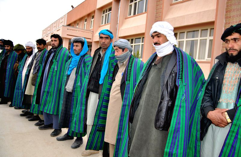 Sarpul (Afghanistan): Taliban fighters attend a surrender ceremony in Sarpul province, northern Afghanistan, Nov. 25, 2014. It is believed that a total of 15 armed militants laid down their weapons ..