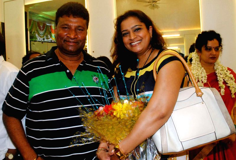 Satish Shetty and Ekta Jain during the opened Shivarama K Bhandary`s sixth hair design saloon in Mumbai on June 30, 2014. - Satish Shetty and Ekta Jain