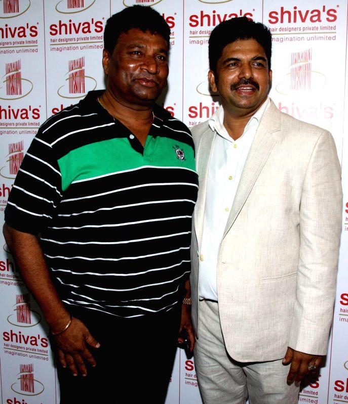 Satish Shetty and Shivarama Bhandary during the opened Shivarama K Bhandary`s sixth hair design saloon in Mumbai on June 30, 2014. - Satish Shetty
