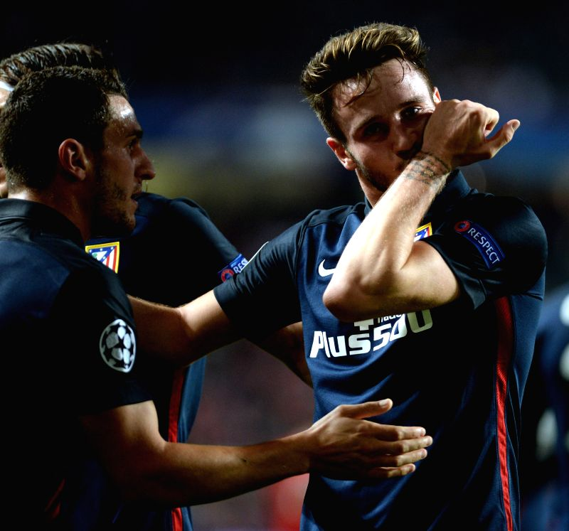 Saul Niguez (R) of Atletico de Madrid celebrates after scoring during the UEFA Champions League Group C football match against Benfica in Lisbon, Portugal, Dec. 8, ...