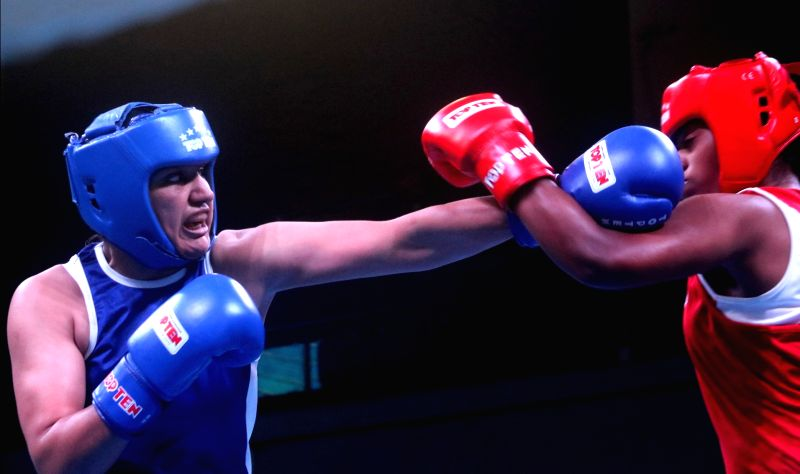 Saweety Boora (Blue) in action against Indraja K.A. during the 1st India Open international boxing tournament in New Delhi, on Jan 28, 2018.