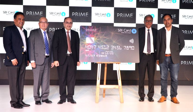 SBI Card CEO Vijay Jasuja, SBI (associate banks)  MD Dinesh Khara and Pizza Hut Chief Brand Officer Prashant Gaur at the launch of SBI Card Prime in New Delhi, on June 13, 2017.