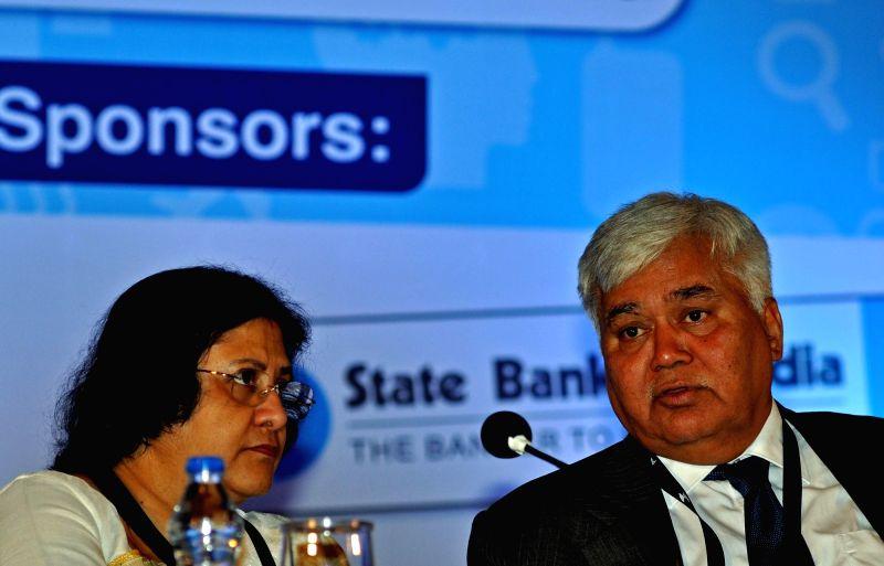 SBI Chairman Arundhati Bhattacharya and TRAI Chairman RS Sharma during INFOCOM 2015 in Kolkata, on Dec 3, 2015.